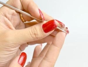 Remove acrylic nails using dental floss